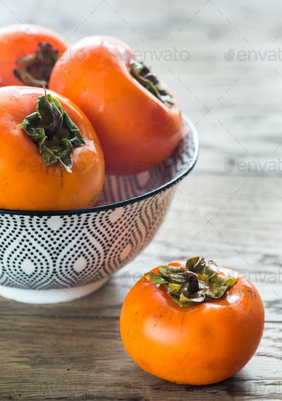 Bowl of fresh persimmons
