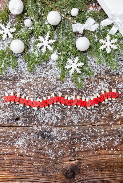 Christmas background with snow, baubles, fir and snowflakes