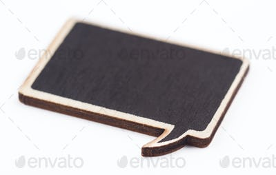 Close up of black wooden blank speech bubble