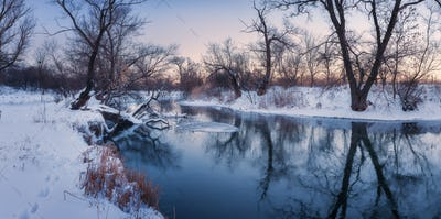 Panoramic winter landscape with trees, beautiful frozen river at