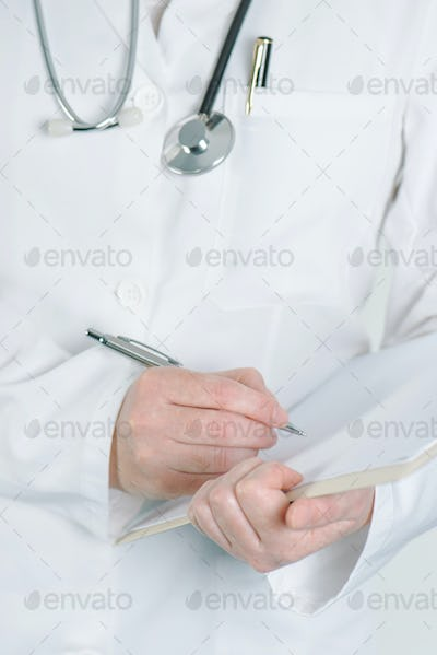 Female doctor writing on clipboard notepad blank paper