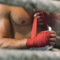 Athletic boxer preparing for fight
