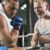 Trainer motivating boxer during training