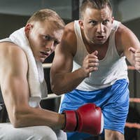 Trainer motivating professional boxer
