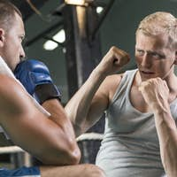Trainer motivating boxer during fight