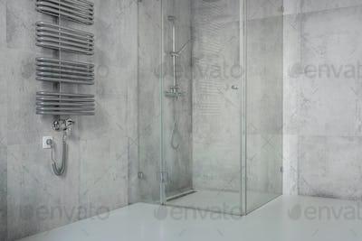 Concrete tiles in modern, spacious bathroom