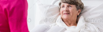 Grandmother in hospital bed