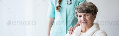 Smailing woman with supportive doctor