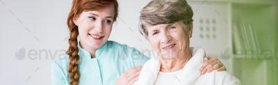 Nurse and elderly patient in hopital