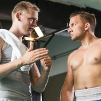 Trainer during training with boxer