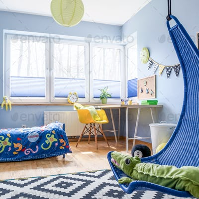 Schoolboy's room arranged in blue and white