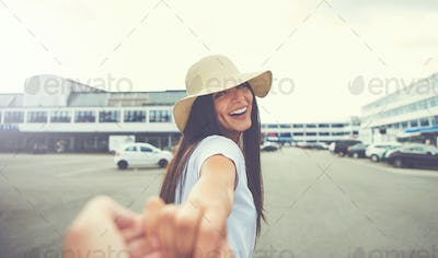 Woman with hand stretched towards camera