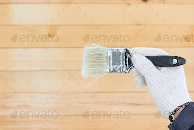 Hand in glove cotton holding brush paints
