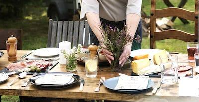 Woman Preparing Table Dinner Concept
