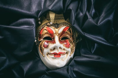 Carnival mask isolated on black satin background