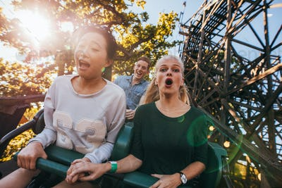 People enjoying a ride in amusement park