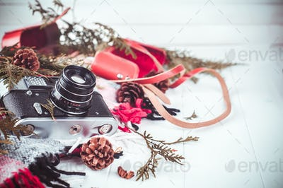 Objects top view lifestyle essentials of artist. Retro vintage film camera and a blanket.
