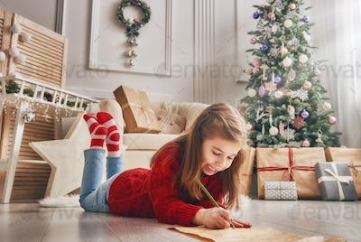 girl writes the letter to Santa Claus