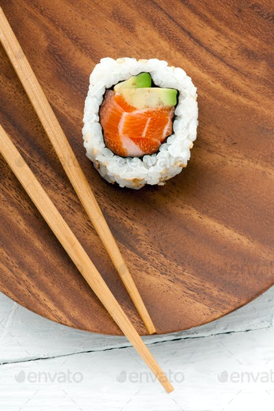 Sushi uramaki roll with salmon and avocado