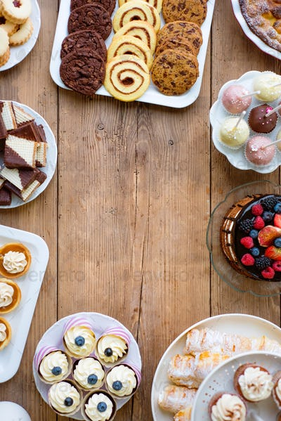 Cake, cookies, cakepops, waffers, cupcakes and tarts. Copy space