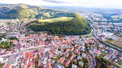 Aerial view of slovak town Banska Bystrica surrounded by hills.