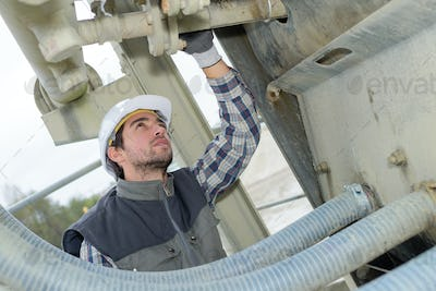 young engineer checking industrial site systems