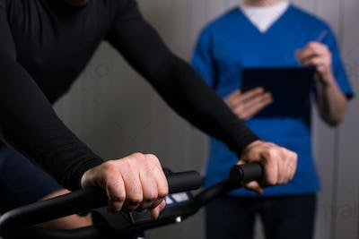 Patient exercising on a stationary bike