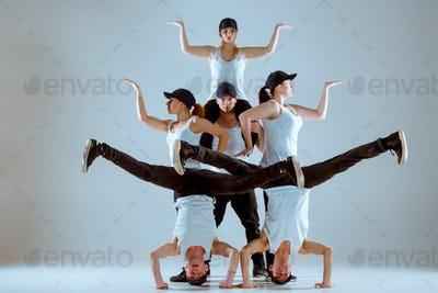 Group of men and women dancing hip hop choreography