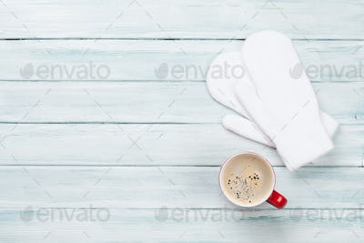 Christmas background with coffee and mittens