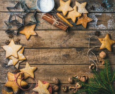 Sweet gingerbread cookies, sugar powder, nuts, spices, molds and fir-brunch
