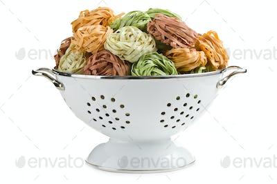 pasta tagliatelle in colander