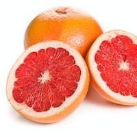 sliced red grapefruit on white