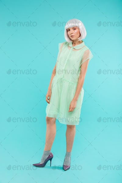 Full length of beautiful stylish woman with blonde hair standing