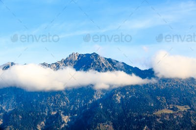 Clouds on mountain tops.  Mountain landscape with clouds. mounta