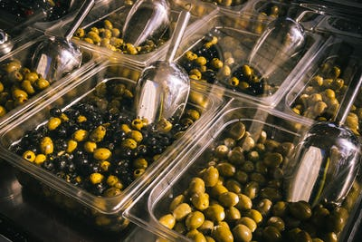 Olives at a market stall. Bowls of olives for sale at a market