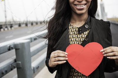 African Woman Holding Heart Shape Symbol Love Concept