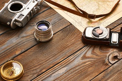 Vintage camera and lens on antique XIX century map