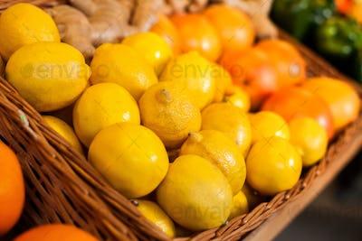 Fresh lemons in wicker boxes.