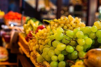 Ripe bunche of grapes in wicker boxes.