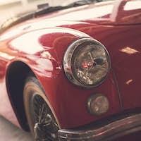 Close up headlight of red Retro classic car