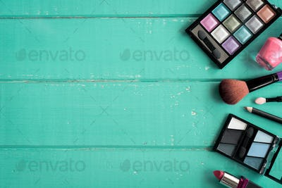 make up with cosmetics and brushes on wooden background