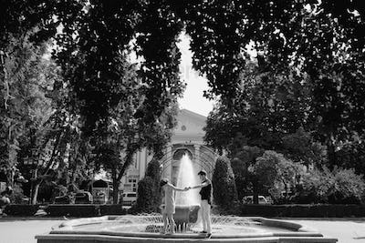 beautiful young couple at the fountain