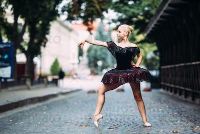 Ballerina posing in the center city