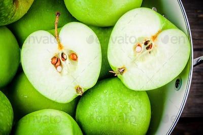 organic green apples in colander