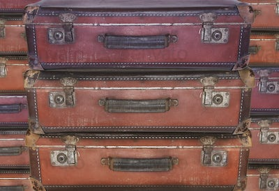 Evacuation - Old worn travel suitcases