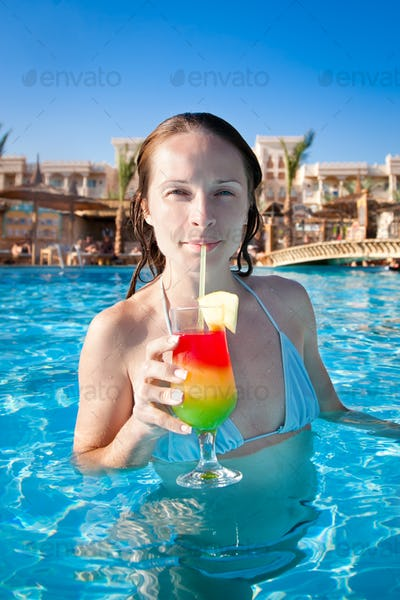 Woman drinking a fruit cocktail