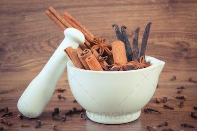 Vintage photo, Fragrant anise, cinnamon and vanilla sticks in mortar