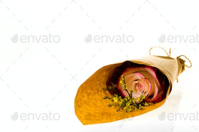 """Bouquet of flowers """"Limonium"""" and """"Sweetness"""" Rose in parchment on a white background"""