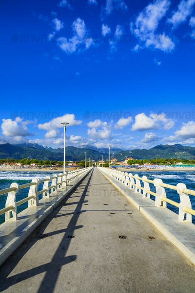 Pier, beach and Apuane mountains in Forte dei Marmi Versilia Tus