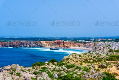 Ocean wave background. Cliff coastline in Sagres, Algarve, Portu